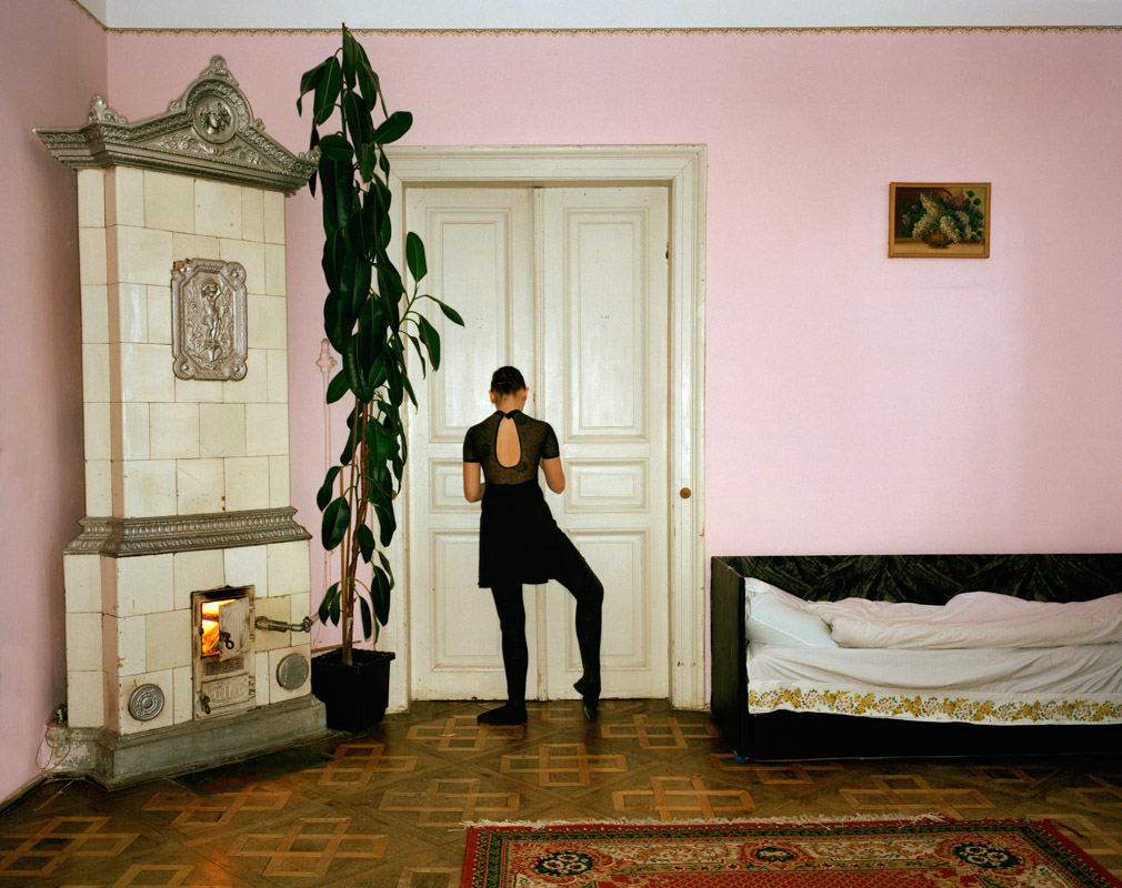 Marta Berezowska, a ballet pupil of Polish descent, does her practice exercises at home in Lviv during the vacation. The interior of her flat on Dudayev Street has echoes from the Habsburg era. Lermontov Street, named after the patriotic Russian writer, was renamed Dudayev Street, after the Chechen separatist killed by the Russian military in 1996, in a telling indication of the sympathies of the city council. Ukrainian nationalism, and anti-Russian sentiment, is perhaps stronger in Lviv than anywhere else in Ukraine. But much of Lviv\'s population is ethnically Russian, and nowhere is the Russian identity stronger than at the ballet, where there is a harmonious mixing of nationalities.