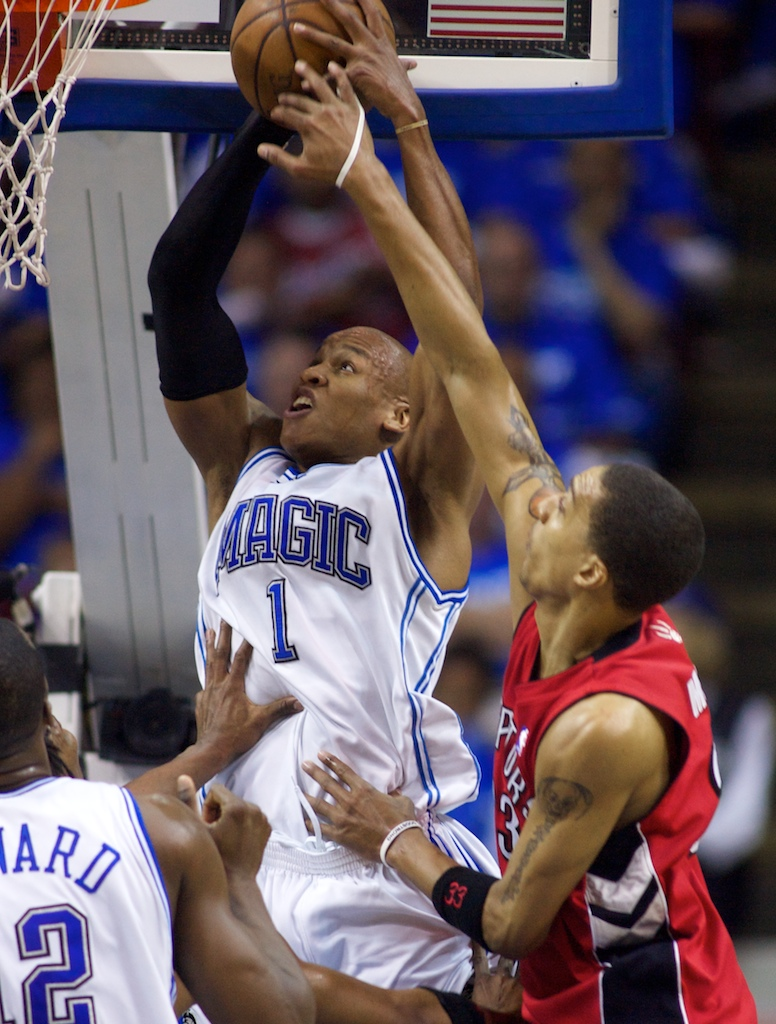 Orlando Magic guard Maurice Evans (1) is fouled by Toronto Raptors forward Jamario Moon (33) during Game Five of the NBA Playoffs at the Amway Arena.