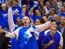 Orlando Magic center Marcin Gortat raises his arms in celebration during the final minutes of Game Five of the NBA Playoffs at the Amway Arena.