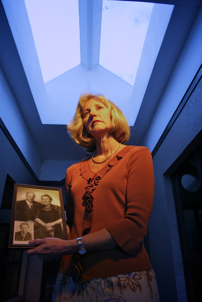 Joanie Schirm holds a portrait of her grandparents who were killed in the Nazi concentration camps.