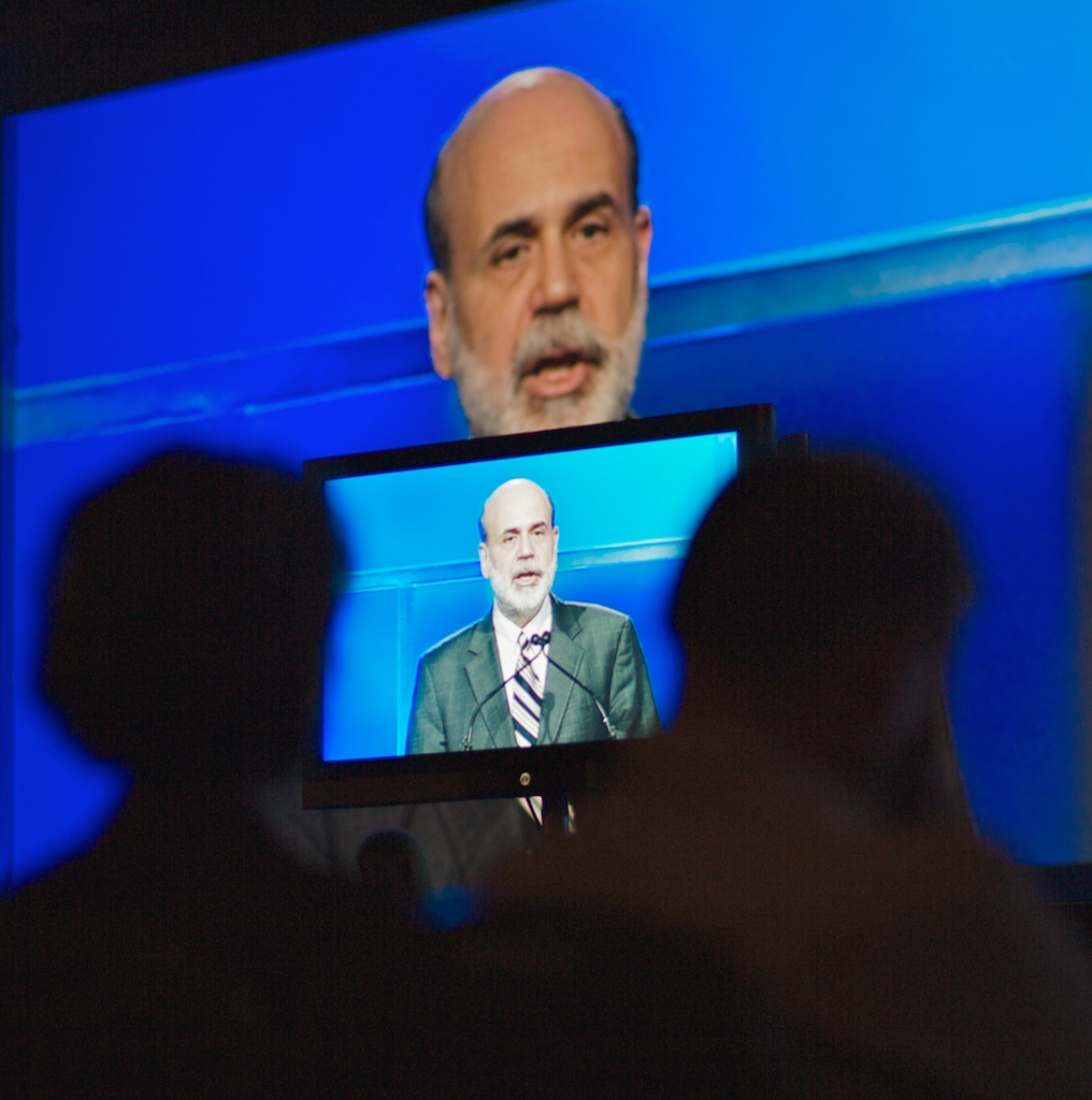 A television monitor projects United States Federal Reserve Chairman Ben Bernanke as he addresses the general session of Independent Community Bankers of America during the ICBA's Convention