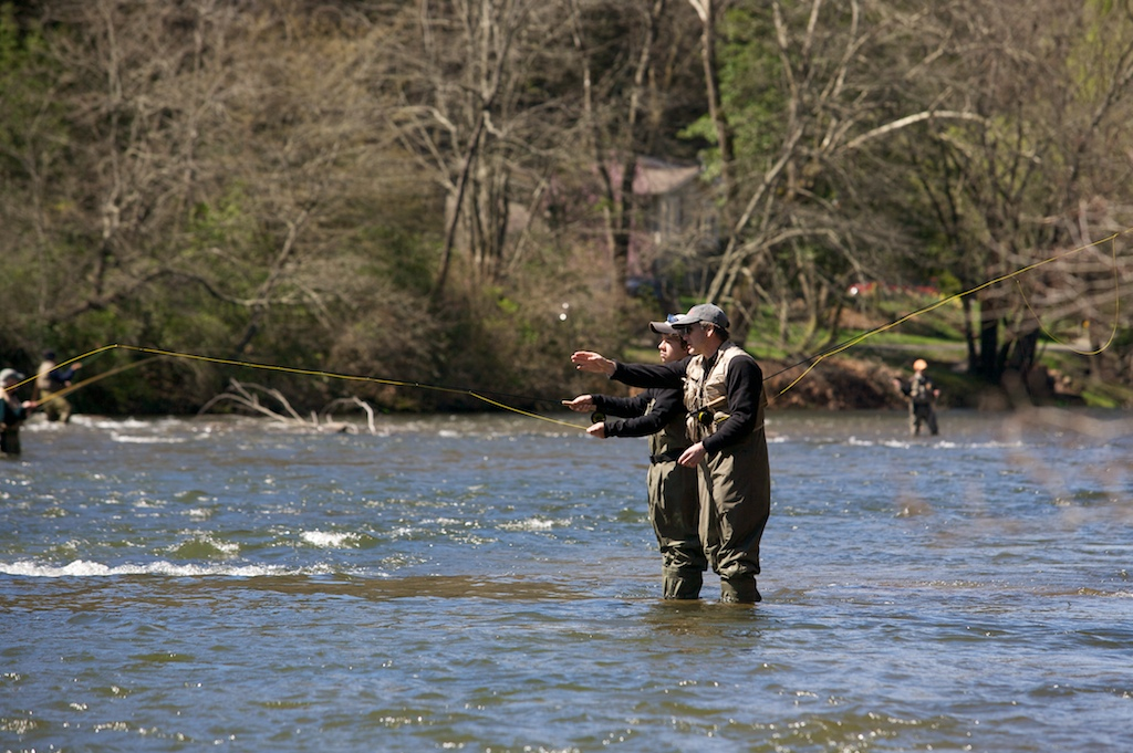 Tal Stephanides, 13, listens to instructions from his father Michael, right, along the Tuckasegee River in Sylva, NC.