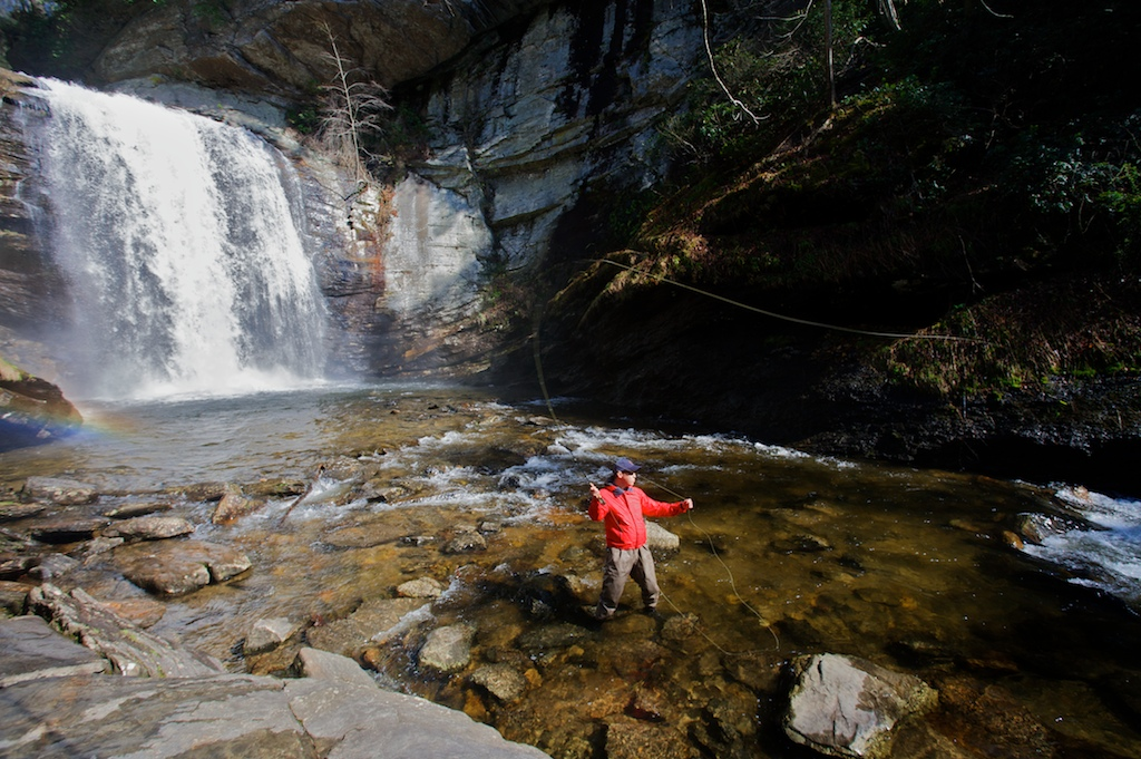 Adam Boruchov casts his line in front of Looking Glass Falls in Davidson, NC.