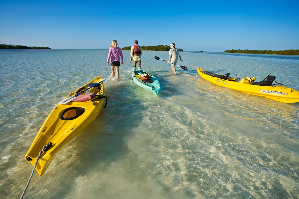 Kayaking guide Andrea Paulson, left, takes Tash Elwyn and Christopher Collier around some of the uninhabited islands off the coast of Sugarloaf Key, FL.