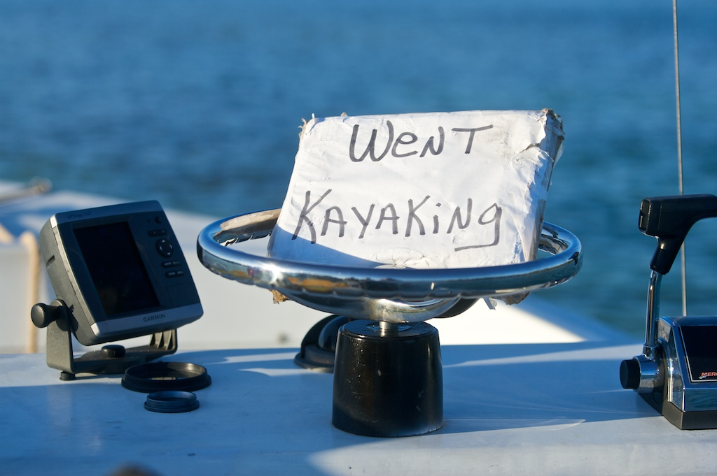 Kayaking guide Andrea Paulson leaves a sign on her boat informing passers-by that she is out kayaking with a group off the coast of Sugarloaf Key, FL.