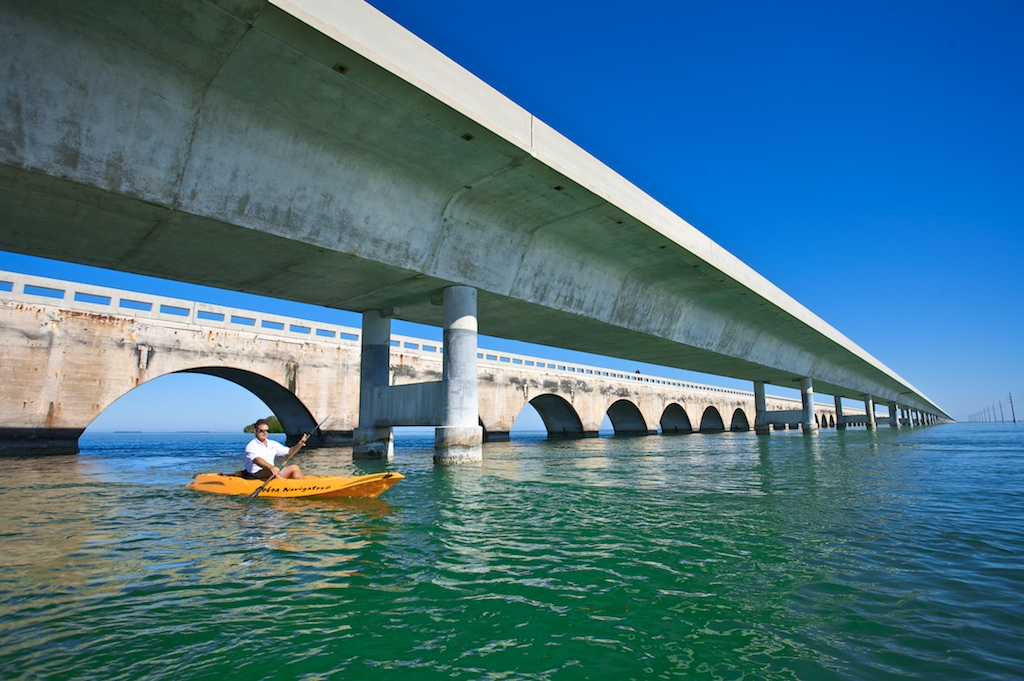 Kayaking guide Dave Kaplan paddles around the Seven Mile Bridge off the coast of Ohio Key, FL.