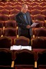 John Loesser, Director of the Lyric Theatre, poses for a portrait inside the theatre.