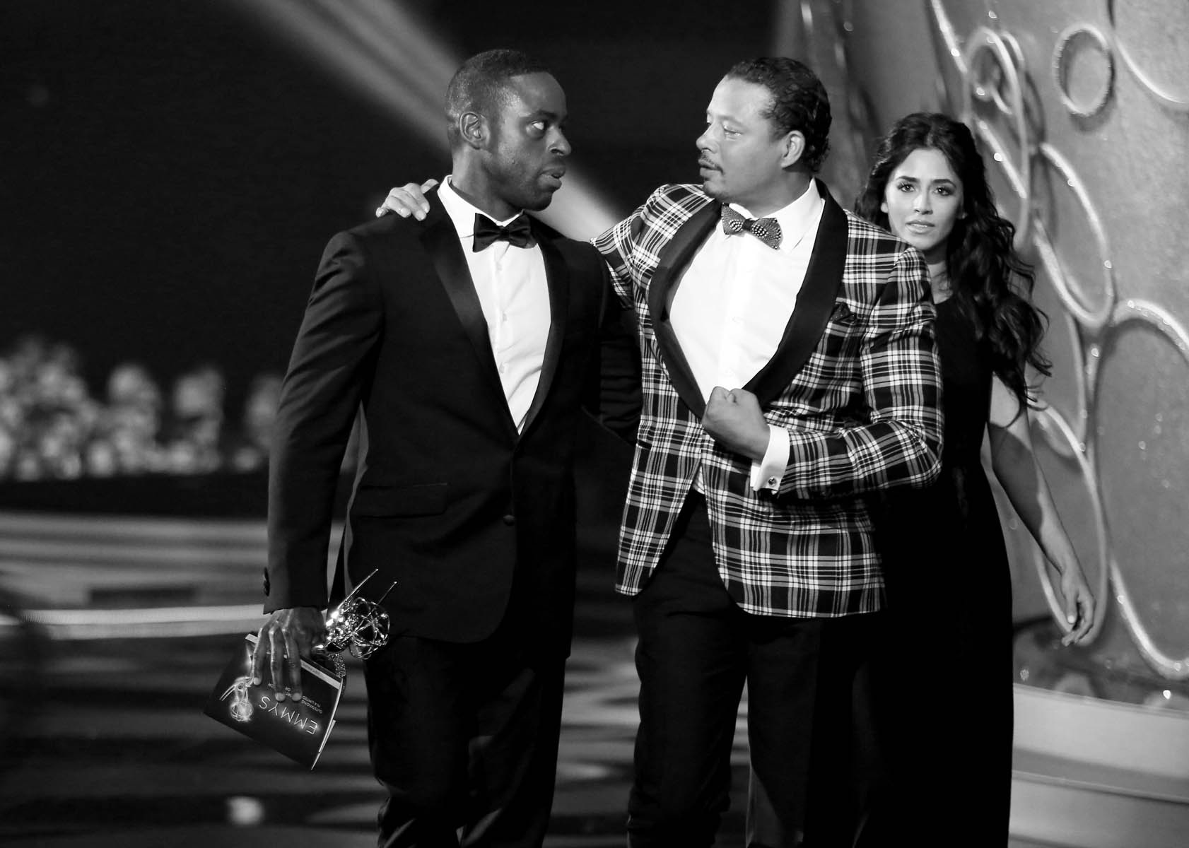 "Sterling K. Brown, left, winner of the award for outstanding supporting actor in a limited series or a movie for ""The People v. O.J. Simpson: American Crime Story"" and Terrence Howard walk off stage at the 68th Primetime Emmy Awards on Sunday, Sept. 18, 2016, at the Microsoft Theater in Los Angeles. (Photo by Matt Sayles/Invision for the Television Academy/AP Images)"