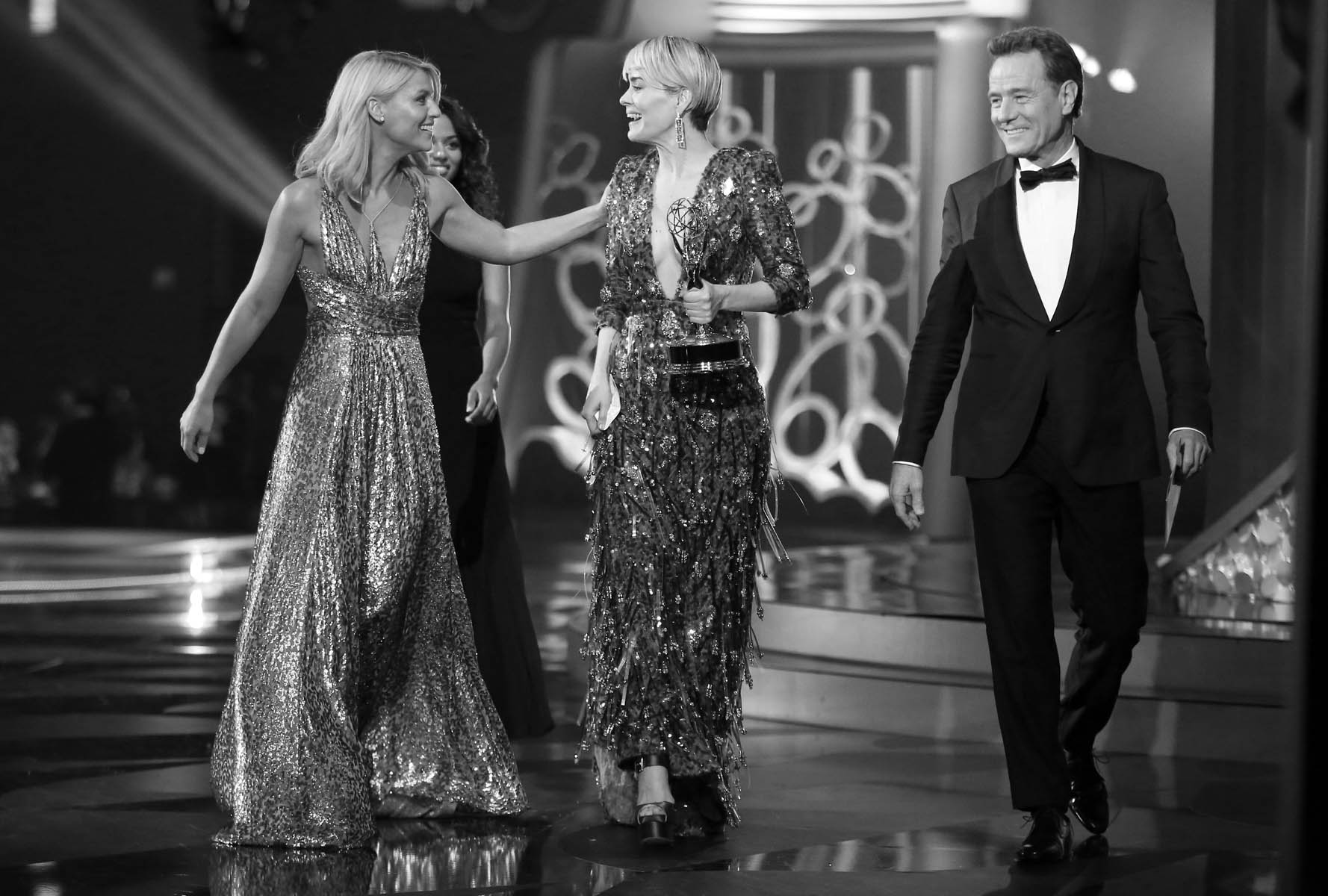 "Sarah Paulson, left,  accepts the award for outstanding lead actress in a limited series or a movie for ""The People v. O.J. Simpson: American Crime Story"" from Claire Danes at the 68th Primetime Emmy Awards on Sunday, Sept. 18, 2016, at the Microsoft Theater in Los Angeles. (Photo by Matt Sayles/Invision for the Television Academy/AP Images)"