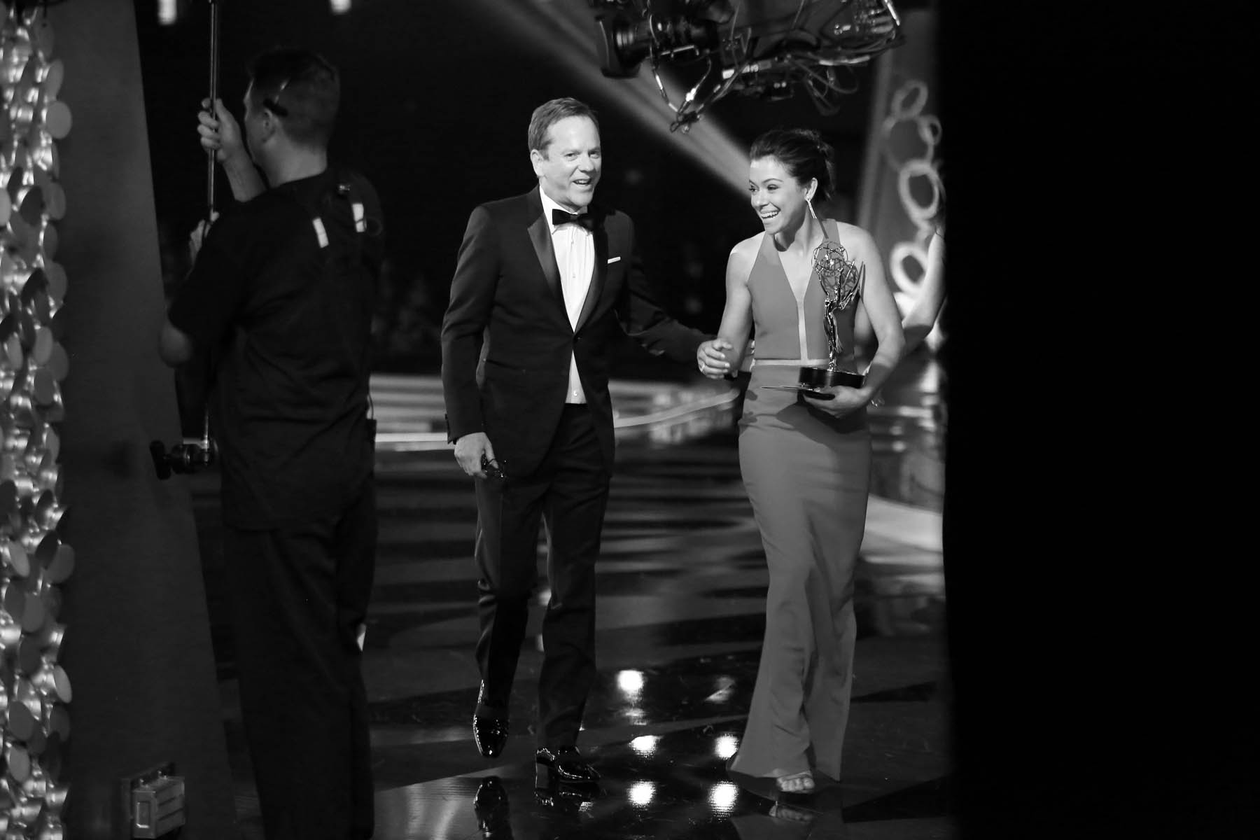 "Tatiana Maslany, right, talks with Kiefer Sutherland after accepting the award for outstanding lead actress in a drama series for ""Orphan Black"" at the 68th Primetime Emmy Awards on Sunday, Sept. 18, 2016, at the Microsoft Theater in Los Angeles. (Photo by Matt Sayles/Invision for the Television Academy/AP Images)"