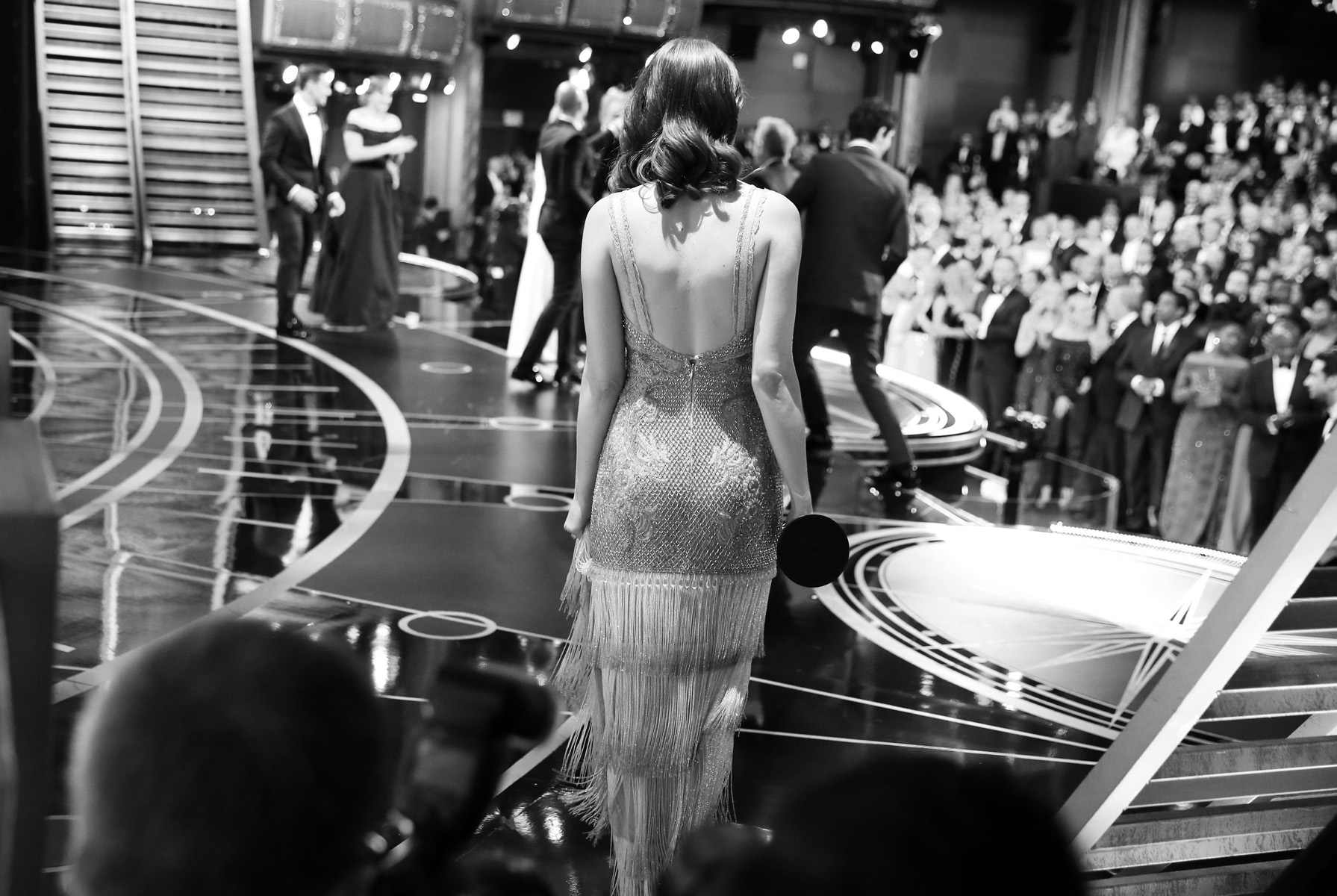 Emma Stone goes on stage with the cast of {quote}La La Land{quote} at the Oscars on Sunday, Feb. 26, 2017, at the Dolby Theatre in Los Angeles.  (Photo by Matt Sayles/Invision/AP)