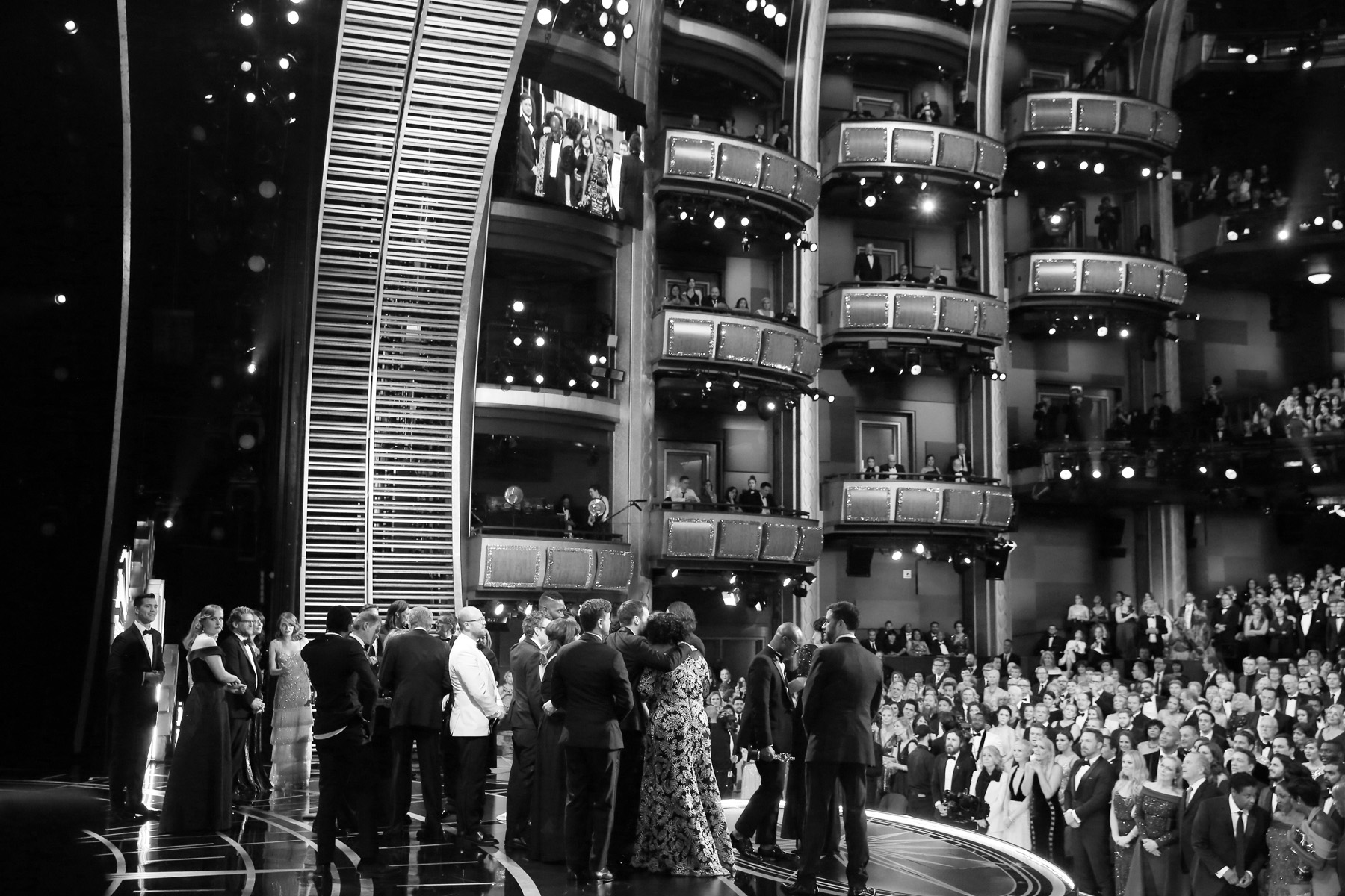 The cast and crew of {quote}Moonlight{quote} accept the award for best picture at the Oscars on Sunday, Feb. 26, 2017, at the Dolby Theatre in Los Angeles. (Photo by Matt Sayles/Invision/AP)