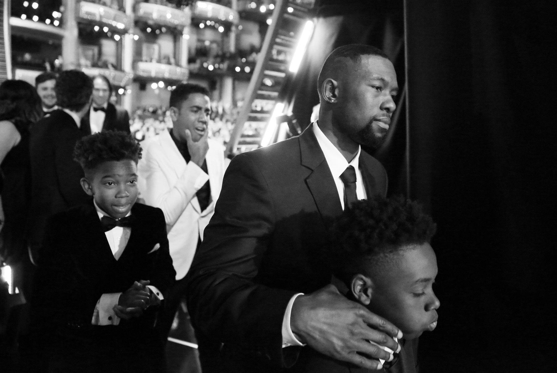 Jaden Piner, from left, Jharrel Jerome, Trevante Rhodes, and Alex R. Hibbert, winners of the award for best picture for {quote}Moonlight,{quote} walk backstage at the Oscars on Sunday, Feb. 26, 2017, at the Dolby Theatre in Los Angeles. (Photo by Matt Sayles/Invision/AP)