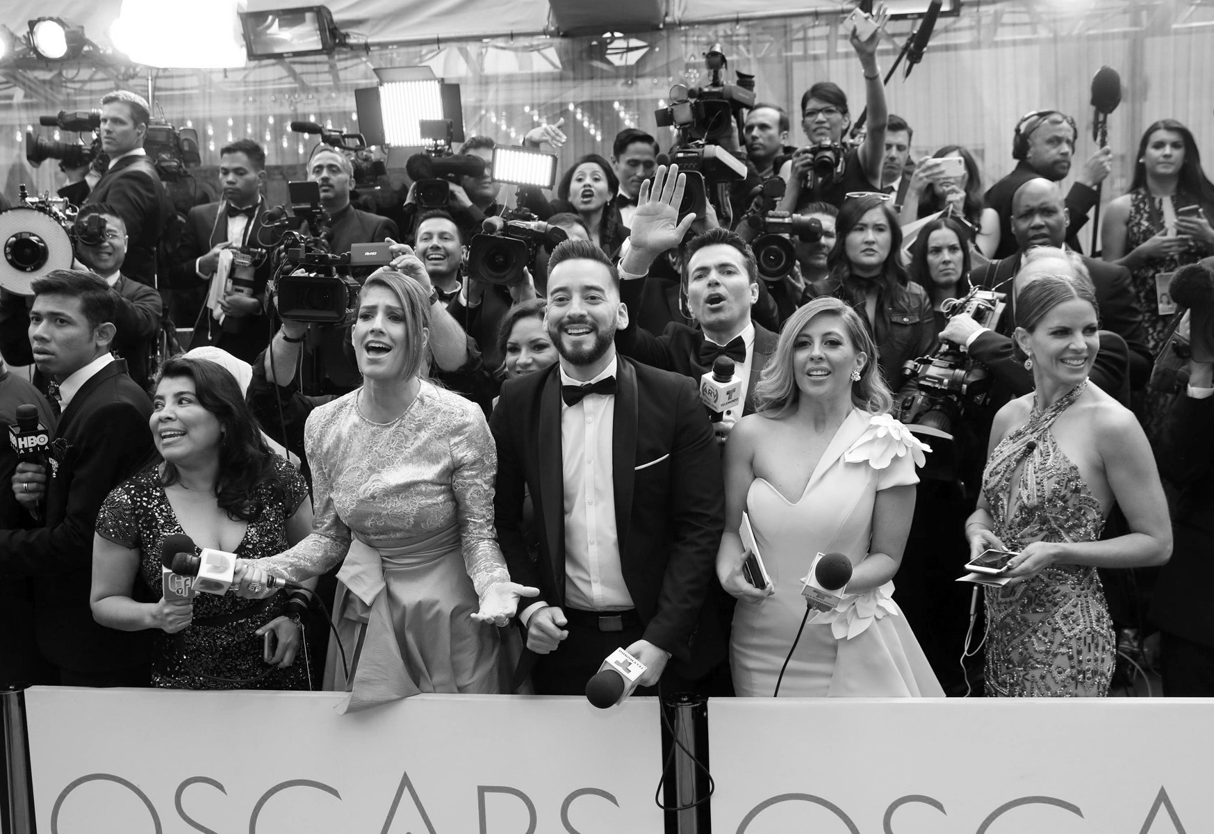 Members of the press react as guests arrive at the Oscars on Sunday, Feb. 26, 2017, at the Dolby Theatre in Los Angeles. (Photo by Matt Sayles/Invision/AP)