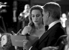 Brie Larson, left, being handed the best actor envelope by accountant Brian Cullinan backstage at the Oscars on Sunday, Feb. 26, 2017, at the Dolby Theatre in Los Angeles. (Photo by Matt Sayles/Invision/AP)