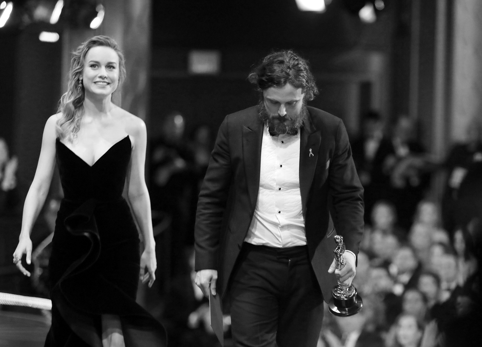 """Brie Larson, left, and Casey Affleck, winner of the award for best actor in a leading role for """"Manchester by the Sea"""",  exit the stage at the Oscars on Sunday, Feb. 26, 2017, at the Dolby Theatre in Los Angeles. (Photo by Matt Sayles/Invision/AP)"""