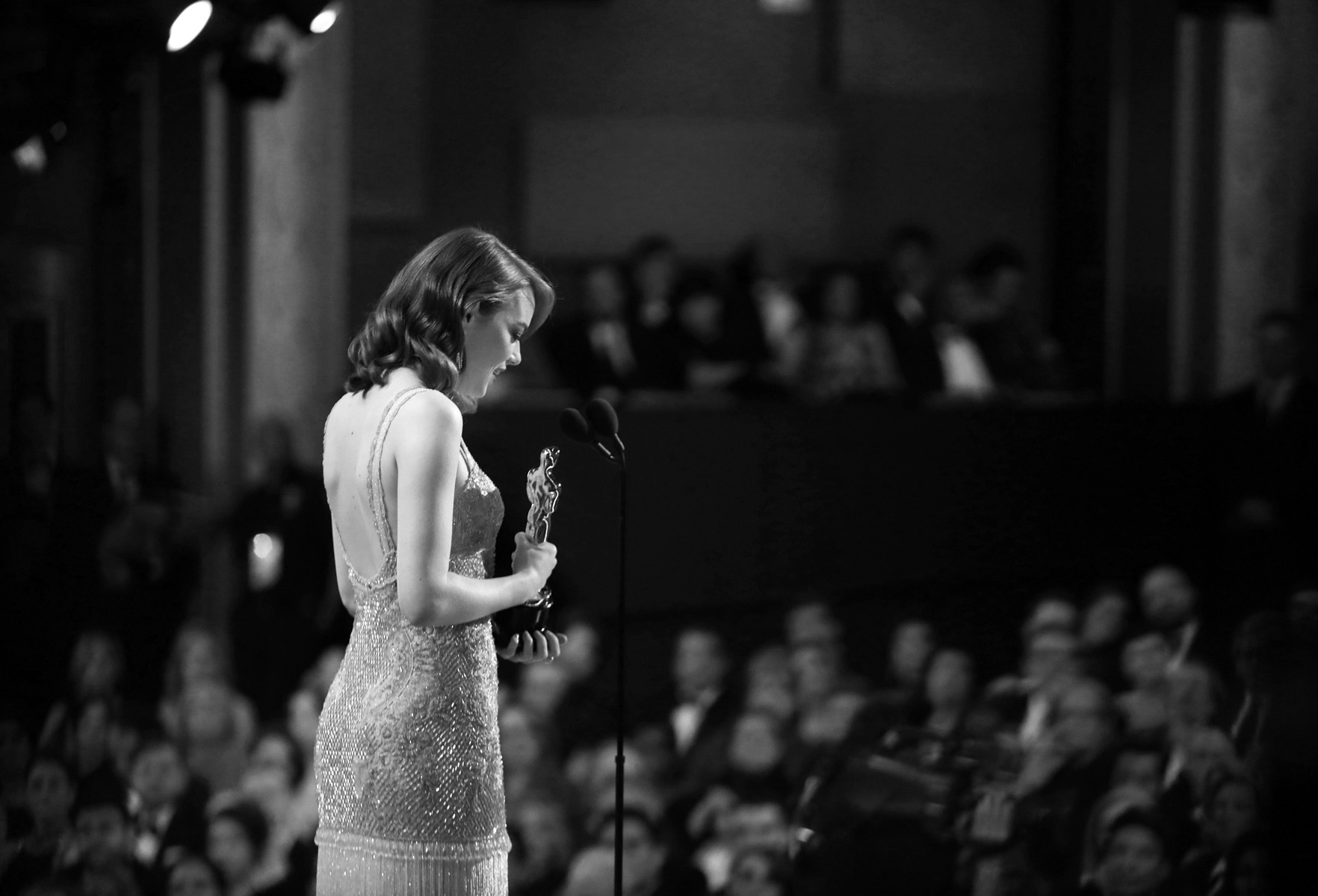 "Emma Stone accepts the award for best actress in a leading role for ""La La Land"" at the Oscars on Sunday, Feb. 26, 2017, at the Dolby Theatre in Los Angeles. (Photo by Matt Sayles/Invision/AP)"