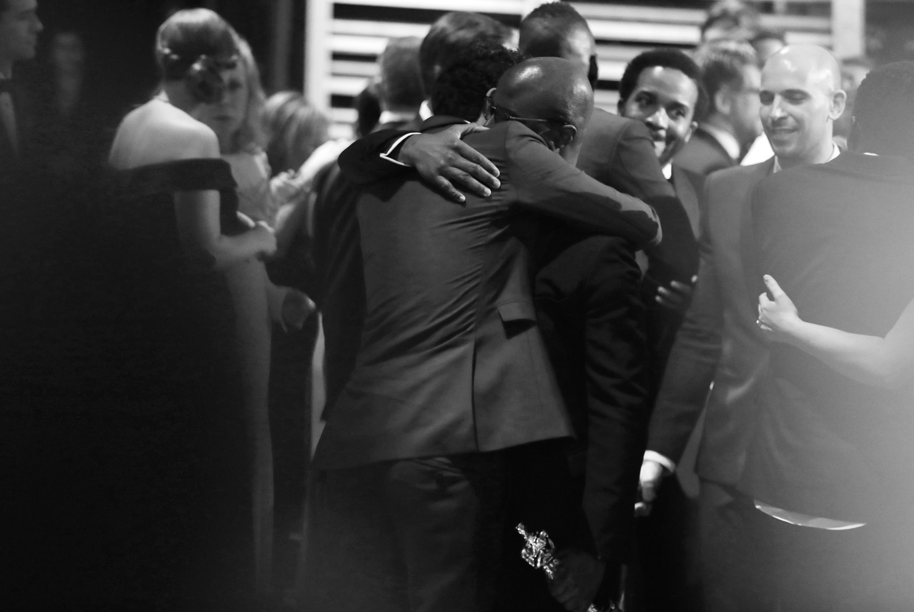 Damien Chazelle, left, congratulates Barry Jenkins as {quote}Moonlight{quote} is announced as the correct winner for best picture at the Oscars on Sunday, Feb. 26, 2017, at the Dolby Theatre in Los Angeles. (Photo by Matt Sayles/Invision/AP)
