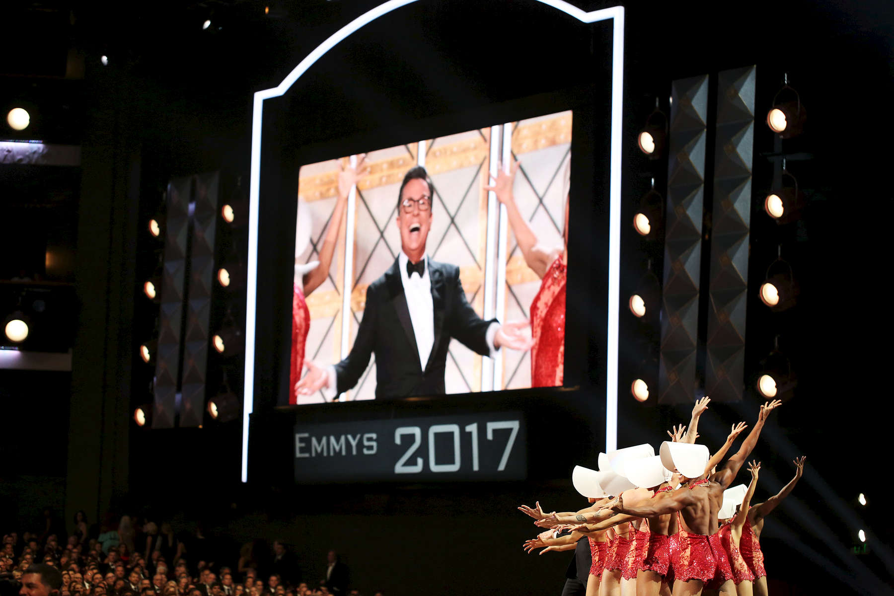Host Stephen Colbert performs at the 69th Primetime Emmy Awards on Sunday, Sept. 17, 2017, at the Microsoft Theater in Los Angeles. (Photo by Matt Sayles/Invision for the Television Academy/AP Images)