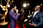 Donald Glover, left and Dave Chappelle appear backstage at the 69th Primetime Emmy Awards on Sunday, Sept. 17, 2017, at the Microsoft Theater in Los Angeles. (Photo by Matt Sayles/Invision for the Television Academy/AP Images)