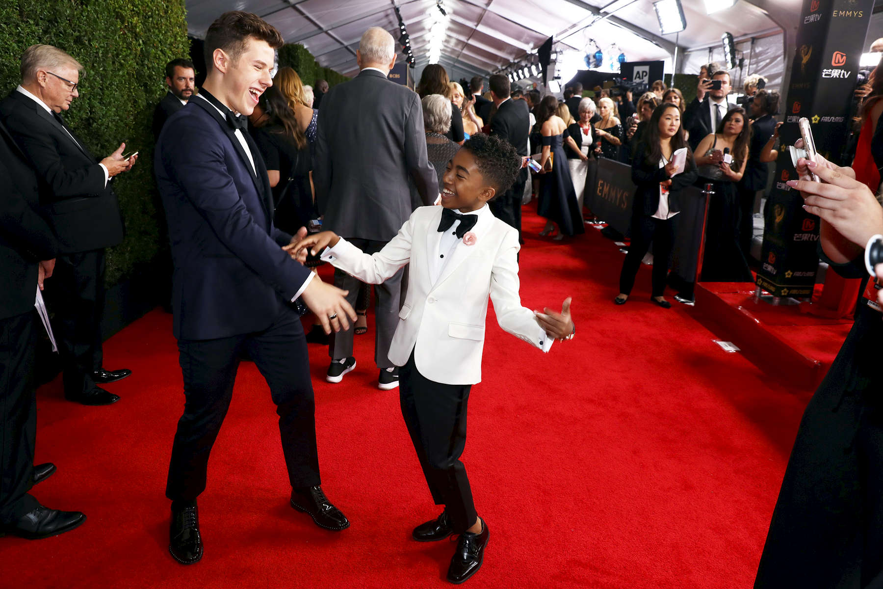 Nolan Gould, left and Miles Brown attend the 69th Primetime Emmy Awards on Sunday, Sept. 17, 2017, at the Microsoft Theater in Los Angeles. (Photo by Matt Sayles/Invision for the Television Academy/AP Images)