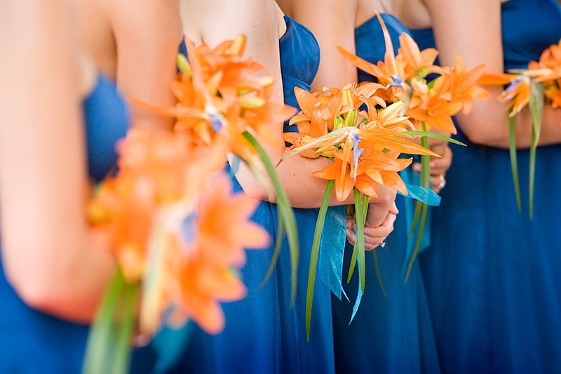 The bridesmaids hold their bouquets during the marriage ceremony on a Costa Rica beach.