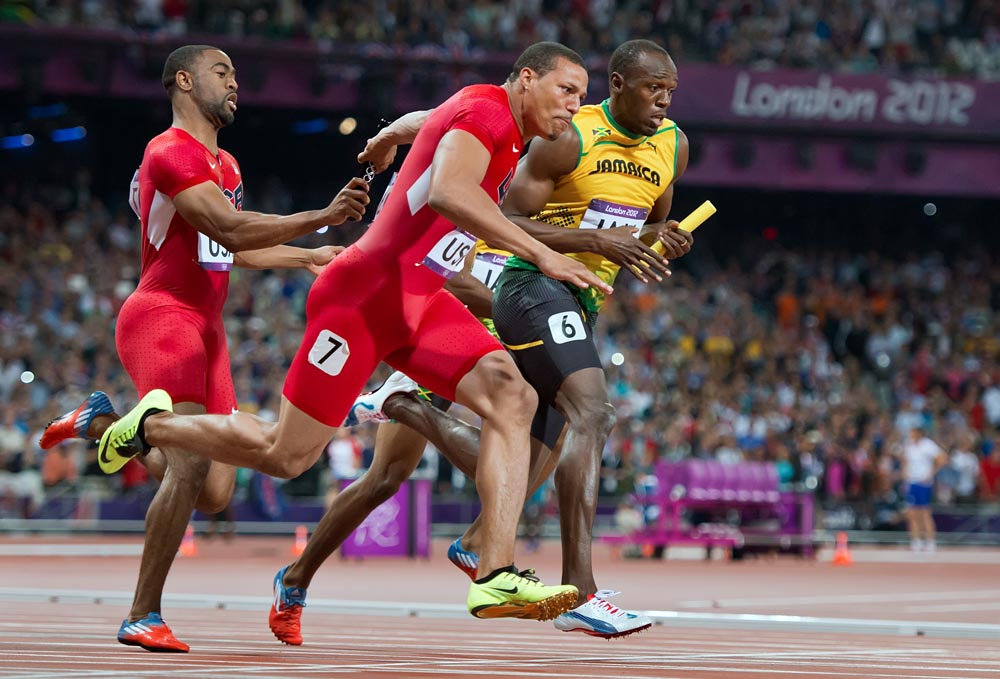 Jamaica's Usain Bolt, right, took the baton on the last leg of the men's 4X100m relay final, setting a world record time of 36.84 at Olympic Stadium during the 2012 Summer Olympic Games in London, England, Saturday, August 11, 2012. At left, Tyson Gay of the United States handed the baton to anchor leg sprinter Ryan Bailey.