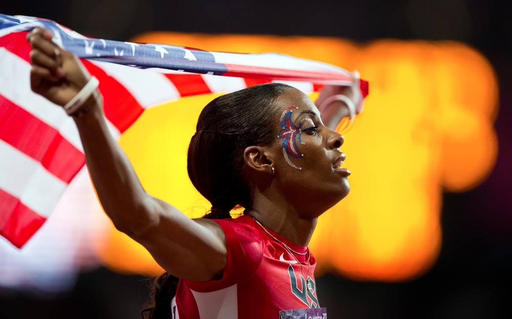 DeeDee Trotter of the United States celebrated following her bronze medal in the women's 400m final at Olympic Stadium during the 2012 Summer Olympic Games in London, England, Sunday, August 5, 2012.