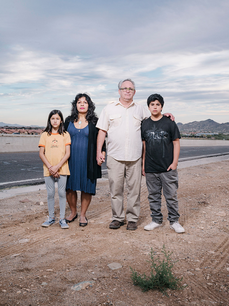 Garrett and Rosie Smith stand for a portrait with their children near the I-17 Exit 229 and Anthem Way where the family was pulled over by police and harrassed by officers. Not only were they harrased, but Rosie, who is Mexican, was questioned by officers seperatly. Shot on November 15, 2017 in Anthem, AZ.