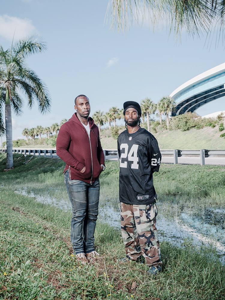 Retired NFL receiver Anquan Boldin stands for a portrait with his cousin CJ a few yards from where his cousin (CJ's brother) Cory Jones was killed by a plain clothes police officer while waiting for roadside assistance, Palm Beach County, October 10, 2017.