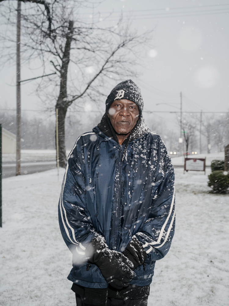 Joseph Gibbs-Bey, poses for a portrait after collecting a case of bottled water at Firehouse #3, Martin Luther King Avenue, Flint, Michigan, January 28, 2016
