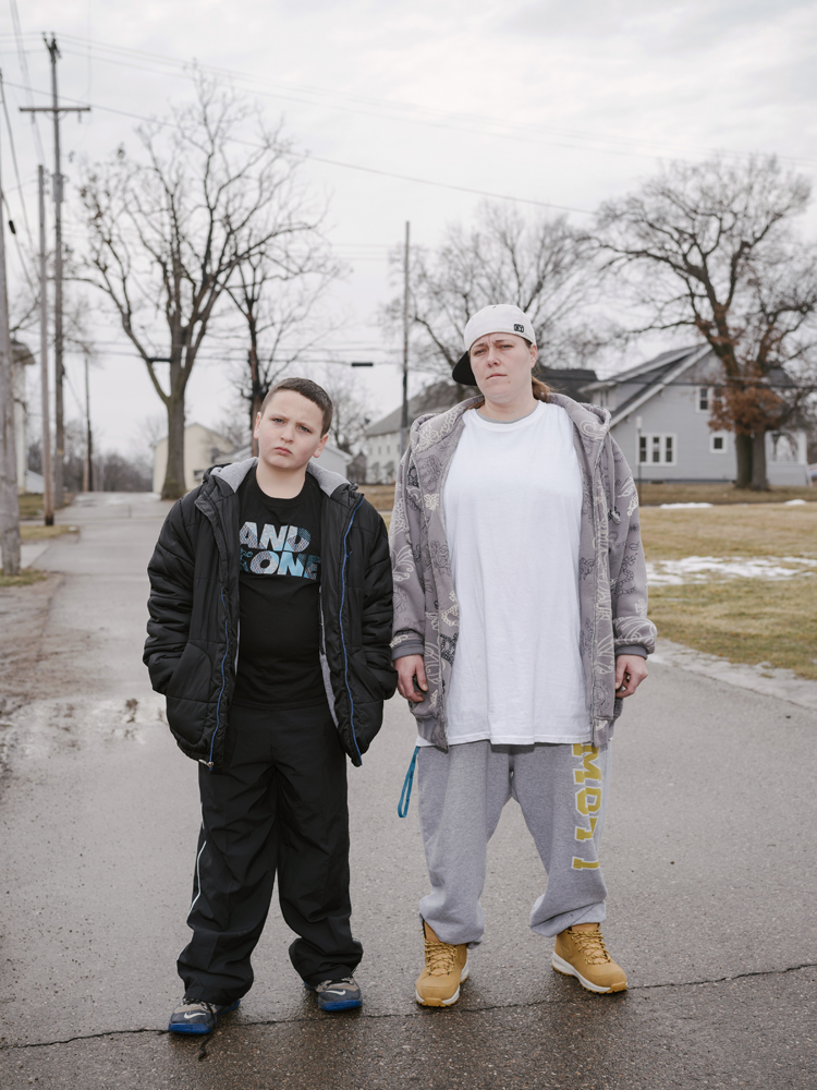Trisha Smith and Tyler Harger pose for a portrait before picking up their daily allowance of bottled water, Martin Luther King Avenue, Flint, Michigan, January 31, 2016.