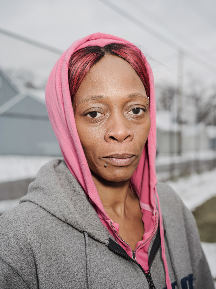 Sherry Joy stops for a portrait on her way to collect her daily allowance of one case of bottled water from Fire House #3, Martin Luther King Avenue, Flint, Michigan, January 27, 2016.