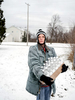 Julie Bennett stops for a photograph after collecting her daily case of water from Firehouse #3, Martin Luther King Avenue, Flint, Michigan, January 27, 2016.