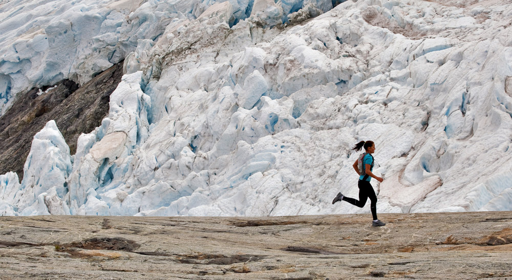 Runner on the glacier and rocks close by. Fiordland New Zealand