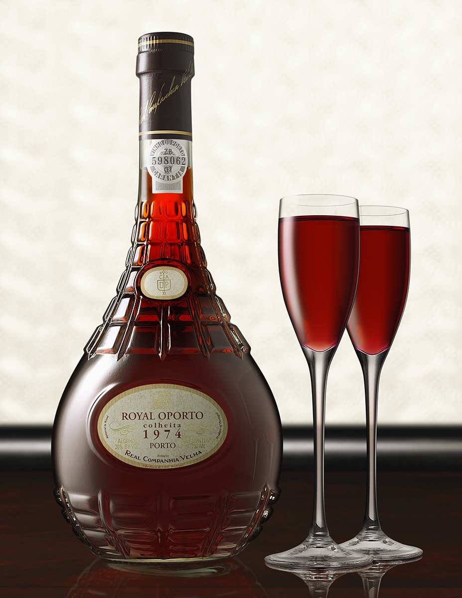 The Royal Oporto bottle is centered with two overlapping aperitif glasses on its' left side. The bar surface is a very rich and dark reflective wood with a padded black bolster. The soft focus background is of a golden textured variety which exhibits a desireable bokeh effect. The camera angle is straight in and the image is presented in a vertical aspect.