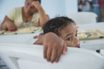 Maquensy, 3, eats lunch at the Senda De Vida Casa Del Emigrante, a center that houses immigrant families seeking shelter before crossing the border, on Wednesday, June 20, 2018, in the border town of Reynosa, Mexico. Maquensy's family has been staying at the center since March after a failed attempt to cross the border when they first arrived.   The family of six fled Honduras in hopes of being granted asylum in the United States, but has since decided to postpone another attempt to cross for fear parents and children being separated from one another.   Maquensy's mother, {quote}Lorena,{quote} says, they can't go back because of the violence, they can't go forward because of U.S. Policies, and Mexico is not somewhere they can stay indefinitely.  AMANDA VOISARD/AMERICAN-STATESMAN