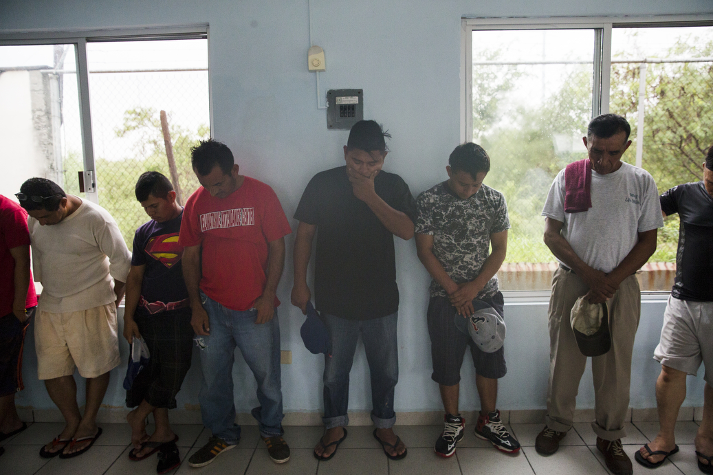 Families pray before lunch at the Senda De Vida Casa Del Emigrante, a center that houses immigrant families seeking shelter before crossing the border, on Wednesday, June 20, 2018, in the border town of Reynosa, Mexico. Many of the families said they were in a sort of limbo at the shelter, fearful to cross to the US because of immigration policies and unable to return to their home countries, from which many said they fled extreme violence.  AMANDA VOISARD/AMERICAN-STATESMAN