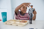 Edison, 7, eats lunch at the Senda De Vida Casa Del Emigrante, a center that houses immigrant families seeking shelter before crossing the border, on Wednesday, June 20, 2018, in the border town of Reynosa, Mexico. Edison's family has been staying at the center since March after a failed attempt to cross the border when they first arrived.  The family of six fled Honduras in hopes of being granted asylum in the United States, but has since decided to postpone another attempt to cross for fear parents and children being separated from one another.   Edison's mother, {quote}Lorena,{quote} says, they can't go back because of the violence, they can't go forward because of U.S. Policies, and Mexico is not somewhere they can stay indefinitely.  AMANDA VOISARD/AMERICAN-STATESMAN
