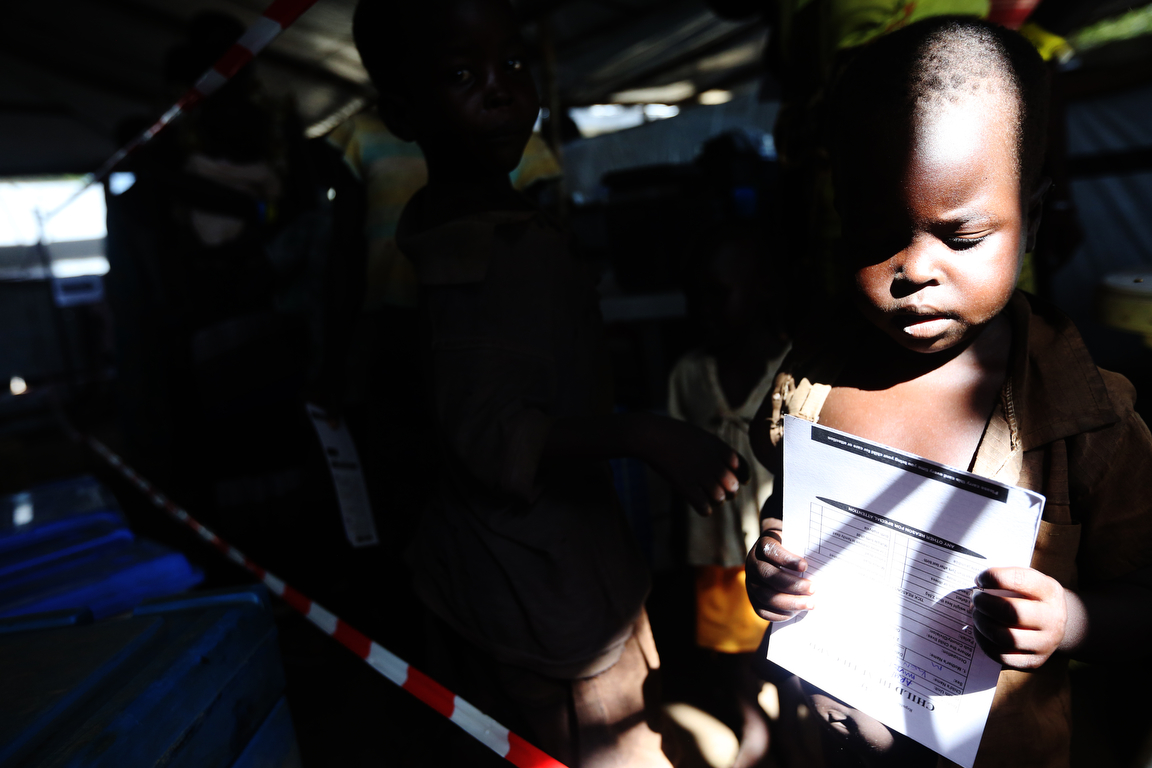 A young child waits to be inoculated at the Imvepi refugee camp reception center in Northern Uganda on Friday, 23 June, 2017. UNHCR reports that 59 percent of those arriving in the camps are children under the age of 18 years.