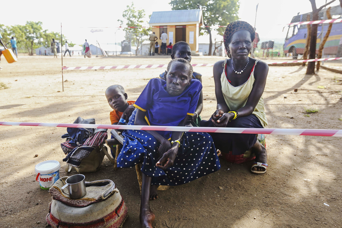 Newly arrived South Sudanese refugees wait for a wheelchair at the reception center at the Imvepi Refugee camp on Friday, 23 June, 2017 in Northern Uganda.  The fastest growing refugee crisis in the world, Uganda is now hosting now more than 1.2 million refugees.  Close to 1 million of which are from South Sudan.