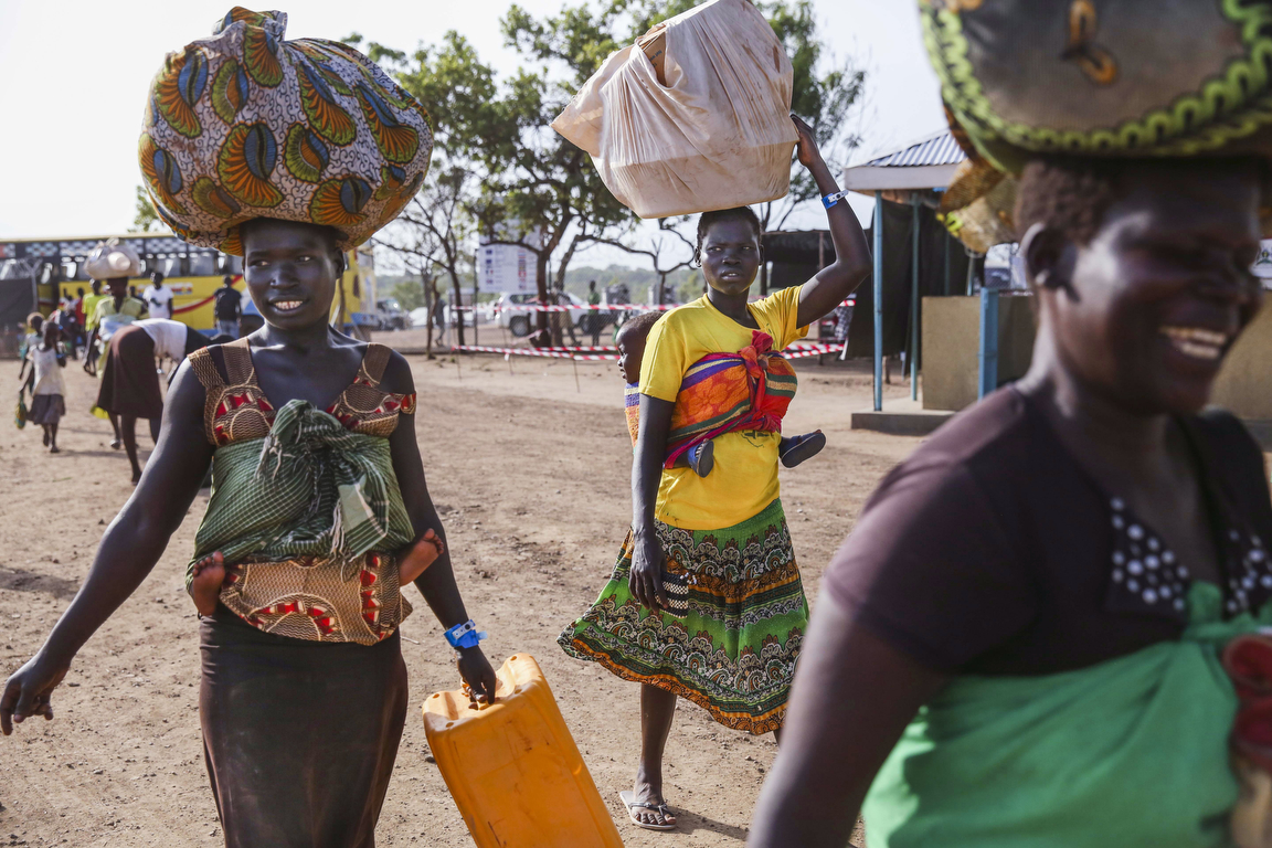 Refugees enter the reception center at the Imvepi Refugee camp after arriving by bus from the Kuluba transit camp on Friday, 23 June, 2017 in Northern Uganda.  The fastest growing refugee crisis in the world, Uganda is now hosting now more than 1.2 million refugees.  Close to 1 million of which are from South Sudan.