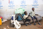 Young boys watch over their families belongings near the reception center at the Imvepi Refugee camp on Friday, 23 June, 2017 in Northern Uganda.  Recent arrivals to the camp are given temporary accommodations outside the center before receiving a designated plot of land.  The fastest growing refugee crisis in the world, Uganda is now hosting now more than 1.2 million refugees.  Close to 1 million of which are from South Sudan.