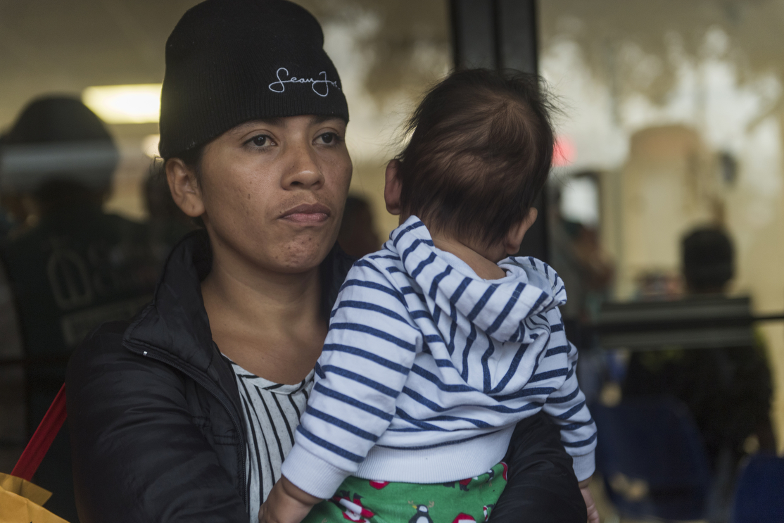 Central American migrant families wait to be taken to the McAllen bus station from the Catholic Charities Humanitarian Respite Center on Tuesday, June 19, 2018, in McAllen, TX.   The families were processed and released by U.S. Customs and Border Protection, and then taken to the center, where they were provided with clean clothes, a shower and meal before embarking to their final destinations.   AMANDA VOISARD/AMERICAN-STATESMAN