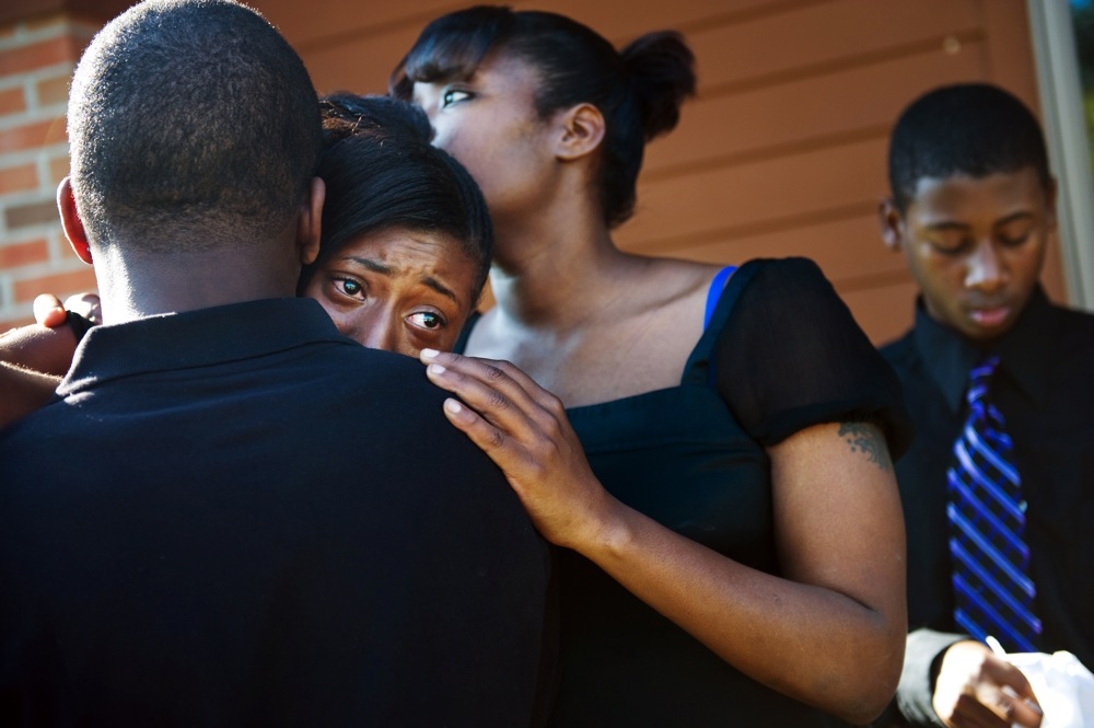 LaShay Taylor is comforted outside her sister, Sierra Taylor's funeral, on Tuesday Oct. 26, 2010.  Sierra, 11, passed away after succumbing to Stage 4 medulloblastoma brain and spinal tumors.