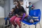 {quote}Lucia{quote} speaks about her experience of fleeing her home country of Guatemala and crossing the border into the United States.  Her children rest at her side at the Catholic Charities Humanitarian Respite Center on Tuesday, June 19, 2018, in McAllen, TX. Many families are processed and released by U.S. Customs and Border Protection, and then taken to the center, where they are provided with clean clothes, a shower and meal before embarking to their final destinations.  AMANDA VOISARD/AMERICAN-STATESMAN
