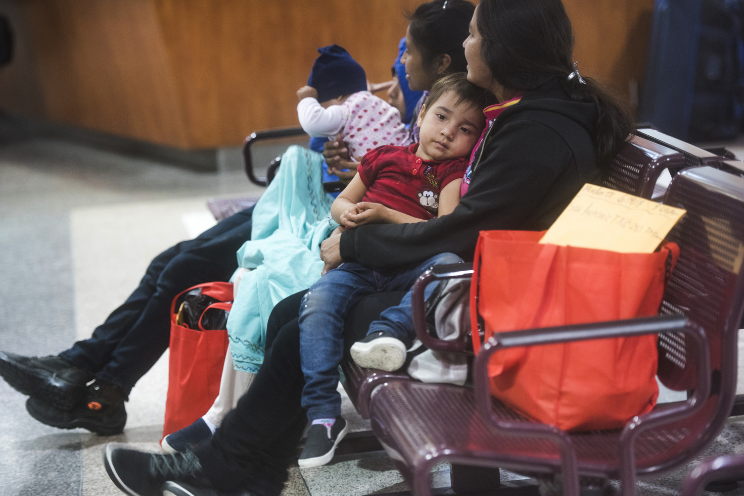 A Guatemalan family waits in the McAllen bus station after leaving border patrol processing and the Catholic Charities shelter on Tuesday, June 19, 2018, in McAllen, TX. AMANDA VOISARD/AMERICAN-STATESMAN