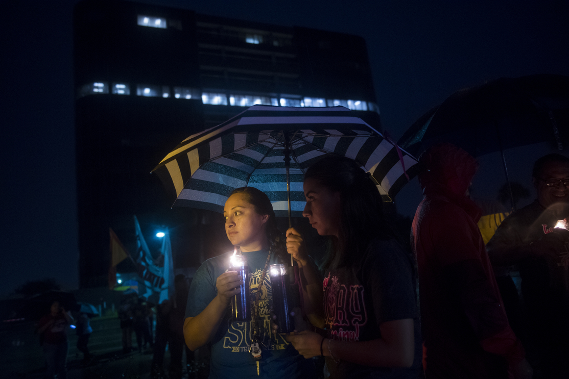 Selena Medina, 23, left, and Josie Sloss, 20, right, attend a vigil and prayer walk on Wednesday, June 20, 2018, in McAllen, TX.  Participants walked from Archer Park to the federal courthouse a few blocks away, in honor of immigrant families and children who have been separated at the border.  AMANDA VOISARD/AMERICAN-STATESMAN