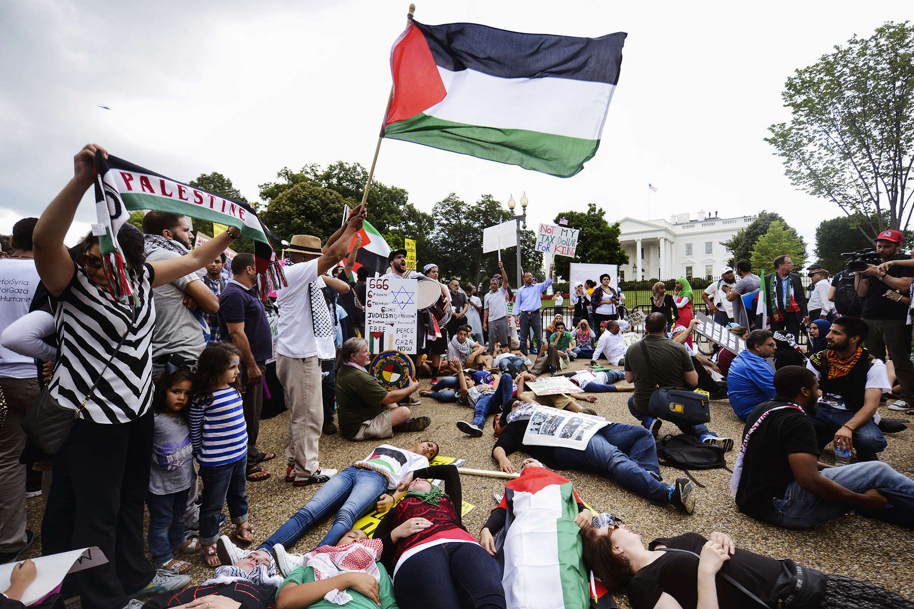 WASHINGTON, DC - AUGUST 2: Demonstrators lay down together in protest, while attending a rally to support the ending of the violence in Gaza rally in front of the White House in Washington, Saturday, Aug. 2, 2014. The group's chants could be heard from the north lawn of the White House.  (Photo by Amanda Voisard/For the Washington Post)