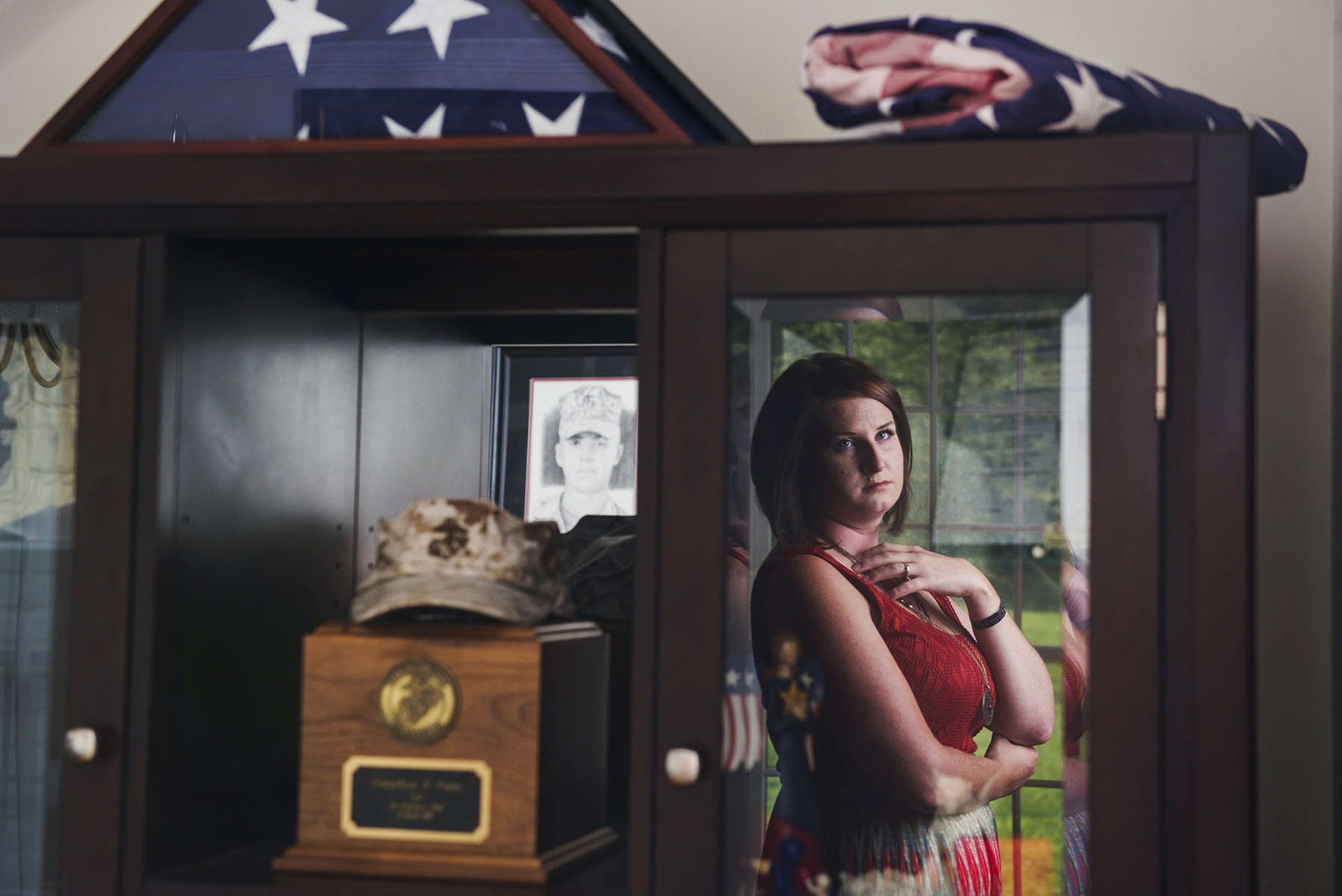 ABERDEEN, MD - AUGUST 6: Rachel Porto's husband Marine LCPL John Porto was killed in Afghanistan when his armored vehicle rolled over in a canal in 2010. Porto is now an advocate and guide to other war widows in pursuing their survivor benefits.  She is seen at her home in Aberdeen, MD on Monday, Aug. 6, 2014. (Photo by Amanda Voisard/For the Washington Post)
